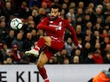 Mohamed Salah scores the third during the Premier League game between Liverpool and Huddersfield Town on April 26, 2019
