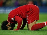 Mohamed Salah kisses the ground after making it five during the Premier League game between Liverpool and Huddersfield Town on April 26, 2019