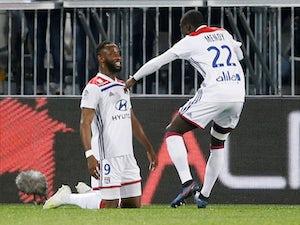 Dembele rescues late Lyon win over 10-man Bordeaux