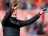 Southampton manager Ralph Hasenhuttl salutes the crowd after their Premier League safety is assured on April 27, 2019