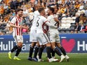 Sheffield United's Enda Stevens celebrates with team mates after scoring their third goal on April 22, 2019