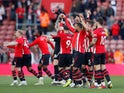 Southampton players celebrate their survival after drawing with Bournemouth on April 27, 2019