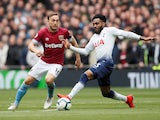 Mark Noble and Danny Rose in action during the Premier League game between Tottenham Hotspur and West Ham United on April 27, 2019