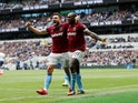 Michail Antonio celebrates with Robert Snodgrass after making the breakthrough during the Premier League game between Tottenham Hotspur and West Ham United on April 27, 2019