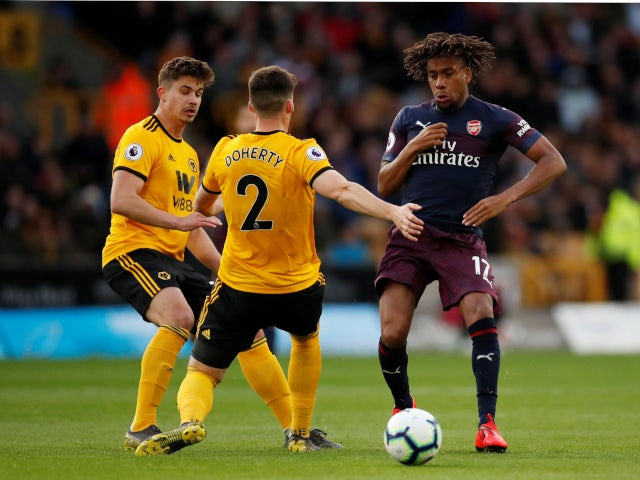 Wolverhampton Wanderers and Arsenal battle for the ball in their Premier League fixture on April 24, 2019.