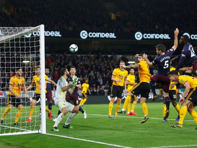 Sokratis Papastathopoulos scores for Arsenal against Wolverhampton Wanderers in the Premier League on April 24, 2019.