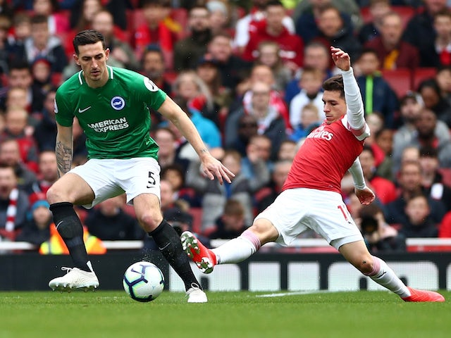Lewis Dunk and Lucas Torreira in action during the Premier League game between Arsenal and Brighton & Hove Albion on May 5, 2019
