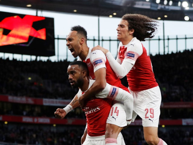 Alexandre Lacazette is pounced on by his teammates after equalising for Arsenal against Valencia in their Europa League semi-final on May 2, 2019