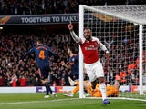 Alexandre Lacazette celebrates after scoring his second of the game in Arsenal's Europa League semi-final first leg against Valencia on May 2, 2019