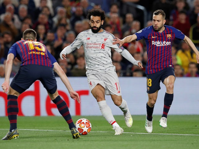 Liverpool's Mohamed Salah in action with Barcelona's Clement Lenglet and Jordi Alba on May 1, 2019