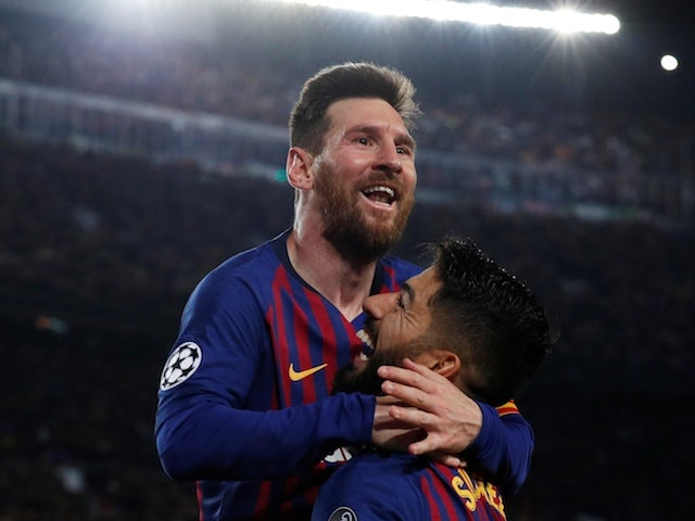 Barcelona forward Lionel Messi just about manages to wriggle away from Joel Matip's pocket enough to score his first against Liverpool on May 1, 2019