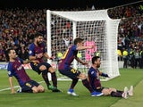 Barcelona players celebrate with Lionel Messi during the Champions League semi-final against Liverpool on May 1, 2019