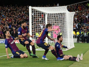 Messi brace puts Barca on brink of final