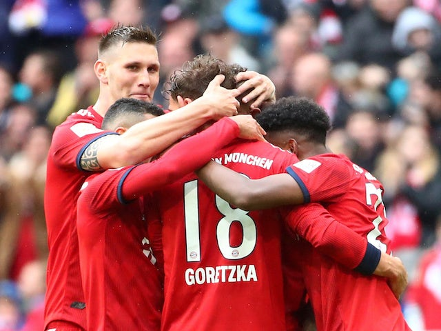 Bayern Munich's Leon Goretzka celebrates scoring their second goal with Niklas Sule and team mates on May 4, 2019