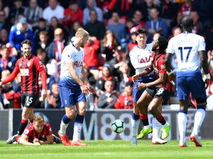 Bournemouth strike late to beat nine-man Spurs