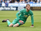 David de Gea on the ground during the Premier League game between Huddersfield Town and Manchester United on May 5, 2019