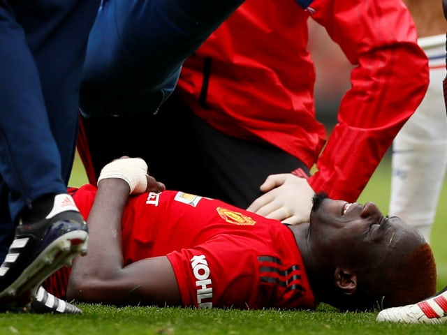 Manchester United's Eric Bailly suffers a knee injury against Chelsea in the Premier League on April 28, 2019.
