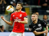 Benfica's Ruben Dias in action with Eintracht Frankfurt's Ante Rebic during a Europa League knockout tie in April 2019.