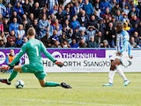 Isaac Mbenza equalises during the Premier League game between Huddersfield Town and Manchester United on May 5, 2019
