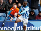 Isaac Mbenza celebrates scoring during the Premier League game between Huddersfield Town and Manchester United on May 5, 2019