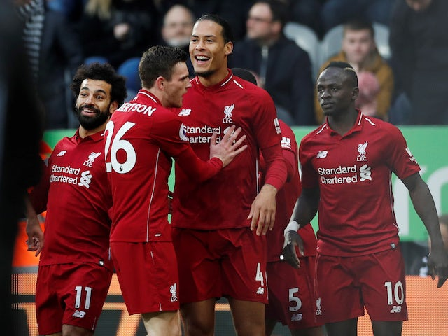 Liverpool defender Virgil van Dijk celebrates scoring with teammates against Newcastle on May 4, 2019