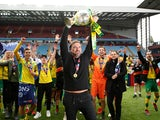 Norwich City celebrate promotion back to the Premier League as champions of the Championship on May 5, 2019