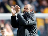 Nuno Espirito Santo applauds the Wolves fans on May 4, 2019
