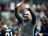 Pep Guardiola celebrates with Manchester City's travelling supporters following the win at Burnley on April 28, 2019