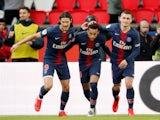 Paris St Germain's Neymar celebrates scoring their first goal with Edinson Cavani and Marco Verratti on May 4, 2019