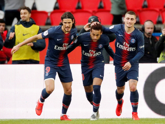 Paris St Germain's Neymar celebrates scoring their first goal with Edinson Cavani and Marco Verratti on May 4, 2019