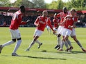 Salford City's Carl Piergianni celebrates scoring their first goal against Eastleigh with teammates on May 5, 2019