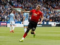 Scott McTominay celebrates scoring during the Premier League game between Huddersfield Town and Manchester United on May 5, 2019