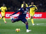 Lyon midfielder Tanguy Ndombele shoots at goal during the Ligue 1 meeting with Nantes on April 12, 2019