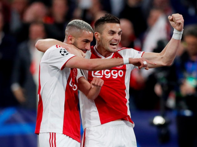 Ajax's Hakim Ziyech celebrates scoring his side's second goal against Tottenham Hotspur with Dusan Tadic on May 8, 2019