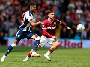 Mason Holgate and Jack Grealish fight for possession as Aston Villa face West Bromwich Albion in the Championship playoffs on May 11, 2019.