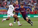 Barcelona's Philippe Coutinho in action with Getafe's Dimitri Foulquier in La Liga on May 12, 2019
