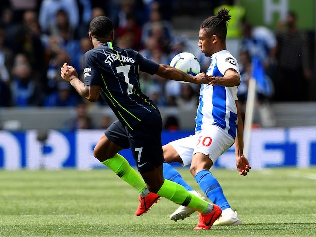 Manchester City's Raheem Sterling battles Brighton & Hove Albion's Bernardo for the ball in the Premier League on May 12, 2019