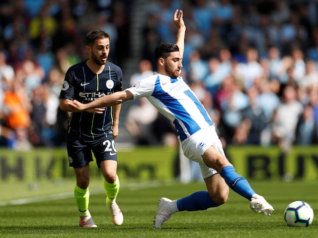 Manchester City's Bernardo Silva in action with Brighton & Hove Albion's Alireza Jahanbakhsh in the Premier League on May 12, 2019