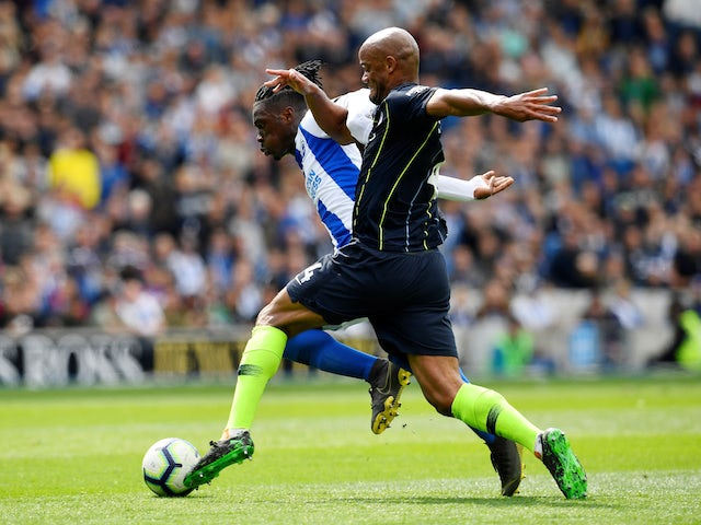 Manchester City's Vincent Kompany in action with Brighton & Hove Albion's Yves Bissouma in the Premier League on May 12, 2019
