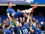 Chelsea captain Gary Cahill is lifted by teammates after his final home appearance for the club on May 5, 2019