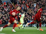 Jordan Henderson and Divock Origi after Liverpool score against Barcelona in the Champions League on May 7, 2019.