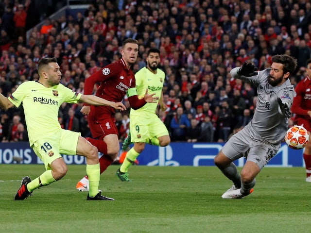 Liverpool's Alisson saves from Barcelona's Jordi Alba in the Champions League on May 7, 2019.