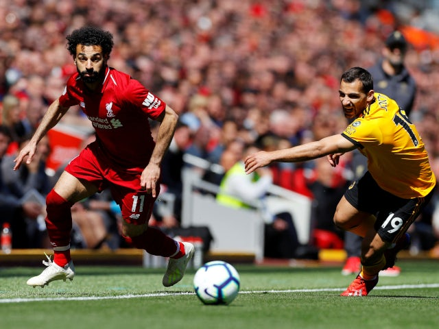 Liverpool's Mohamed Salah beats Wolverhampton Wanderers's Jonny Otto to the ball in the Premier League on May 12, 2019.