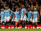 Vincent Kompany celebrates with teammates after firing in the opener during the Premier League game between Manchester City and Leicester City on May 6, 2019