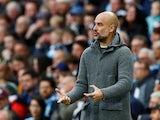 Pep Guardiola gives instructions during the Premier League game between Manchester City and Leicester City on May 6, 2019