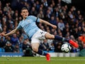 Phil Foden takes a shot during the Premier League game between Manchester City and Leicester City on May 6, 2019