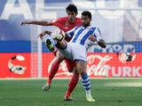 Real Madrid's Jesus Vallejo in action with Real Sociedad's Willian Jose on May 12, 2019