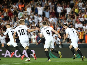 Valencia's players celebrate Kevin Gameiro's early goal against Arsenal in their Europa League semi-final second leg on May 9, 2019