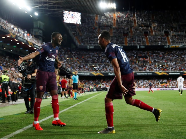 Pierre-Emerick Aubameyang celebrates with Ainsley Maitland-Niles after scoring his second goal against Valencia on May 9, 2019