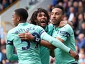 Arsenal's Pierre-Emerick Aubameyang celebrates with Mohamed Elneny and Joe Willock after scoring their first goal on May 12, 2019